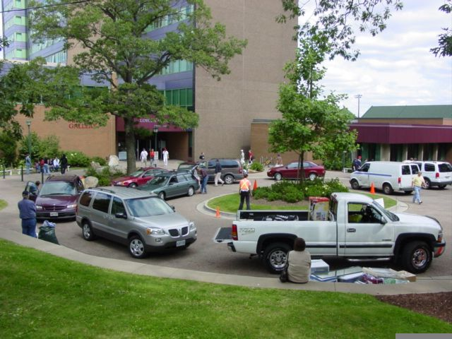 Lots of cars outside the residence building as move-in day commences, circa 2006.